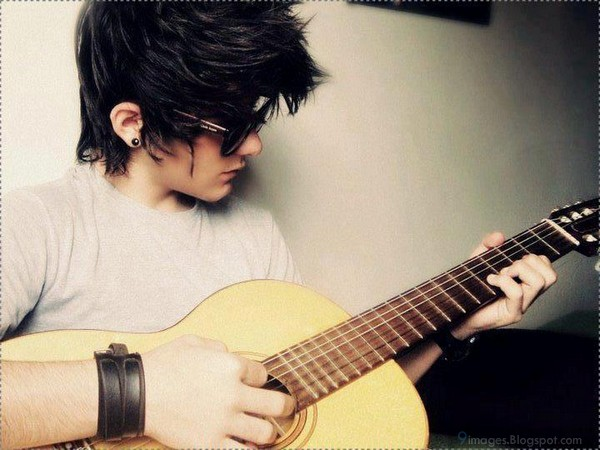Cute alone boy playing guitar cool
