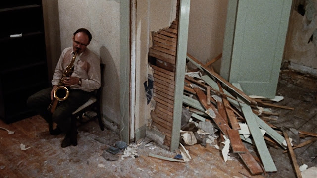 gene hackman playing saxophone in the movie the conversation
