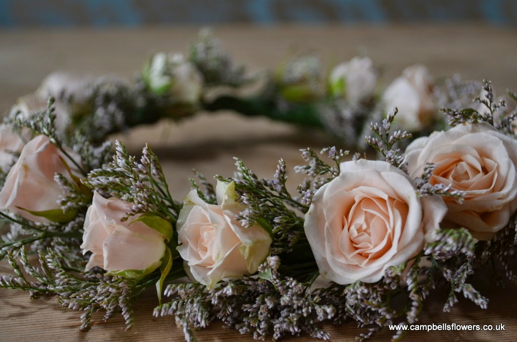 A natural looking floral wedding crown for a beautiful bride.