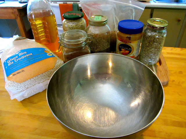 ingredients on the counter with a large empty stainless steel bowl