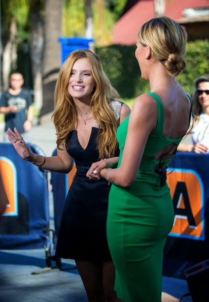 Okay fine, the proof is right there on whether or not cosmetics helps your elegant charm. Now everyone reading this! Bella Thorne is more looked sophisticated on day by day as she stole the limelight again in Extra Show at Los Angeles, USA on Monday, September 15, 2014.