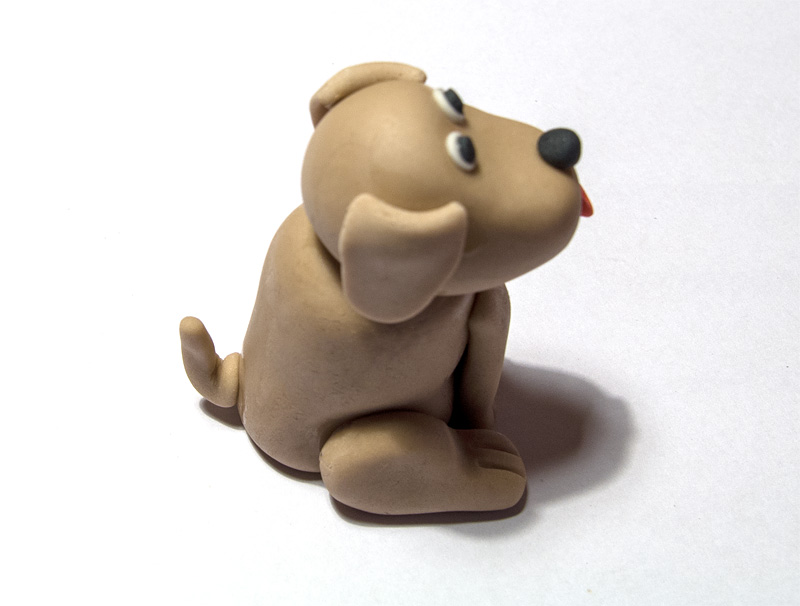 Dog fondant figurine tail on body