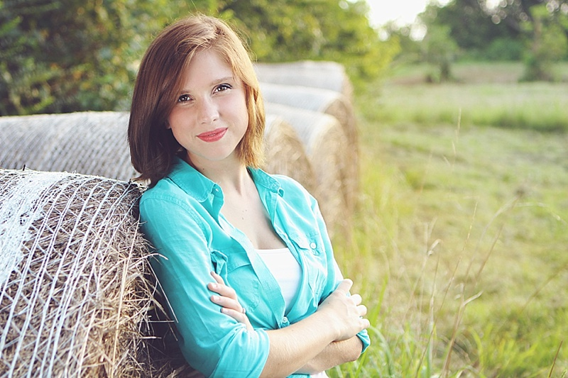 The Persimmon Perch - Senior Pictures next to Haybales
