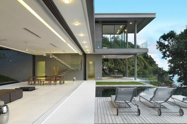 Photo of modern villa interiors as seen from the terrace through the large opening on the house