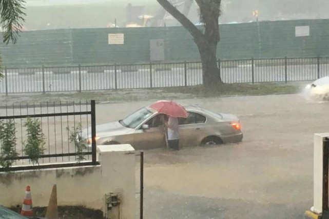 Outside Church of St Vincent de Paul along Yio Chu Kang Road. Since about 2pm on Saturday, PUB had warned about the high risks of floods occurring in many places including Tampines Road, Cactus Road, Seletar Road and central areas such as Exeter Road and Somerset Road.