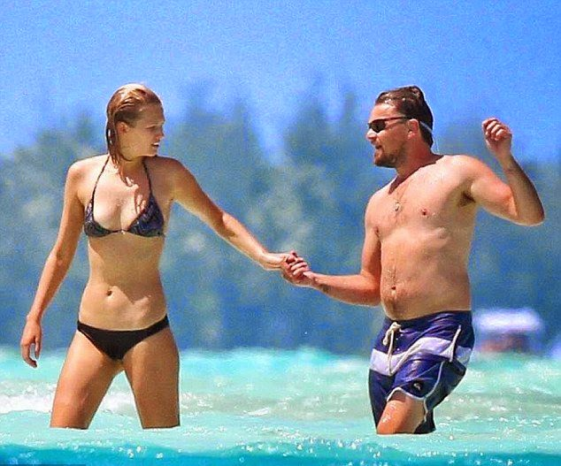 Leonardo DiCaprio couldn't keep his hands off girlfriend Toni Garrn while sharing a romance moment in Miami on Friday,‭ ‬April‭ ‬11,‭ ‬2014‭ ‬in Bora Bora.