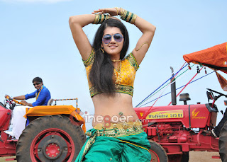 Tapsee Panu in yellow blouse Green Half Saree Spicy Dance Stills