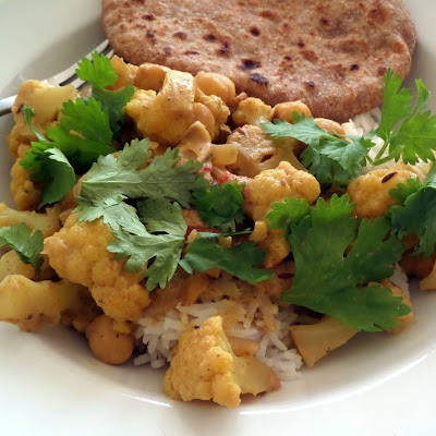 Cauliflower and Chickpea Curry:  A flavorful vegetarian curry made with cauliflower, chickpeas, and spices.