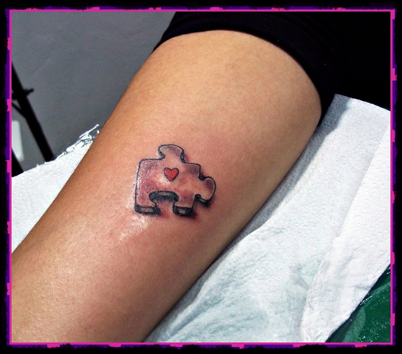 tattoo quebra cabeça title=