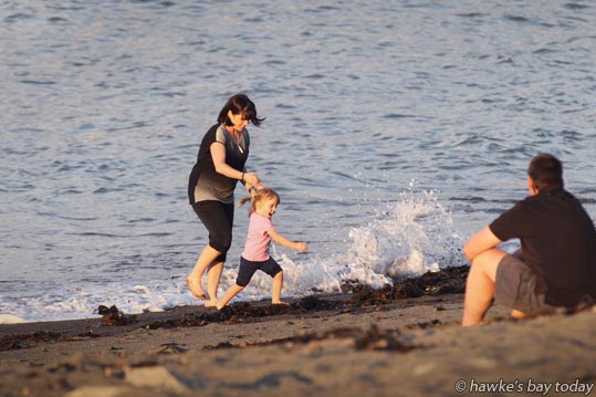 L-R: Elizabeth Eden, Sophia Eden, 3, Taupo, playing in the waves on the water's edge at Hardinge Rd Beach, East Pier, Ahuriri, Napier. photograph