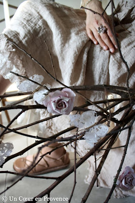 Old paper roses hung on branches