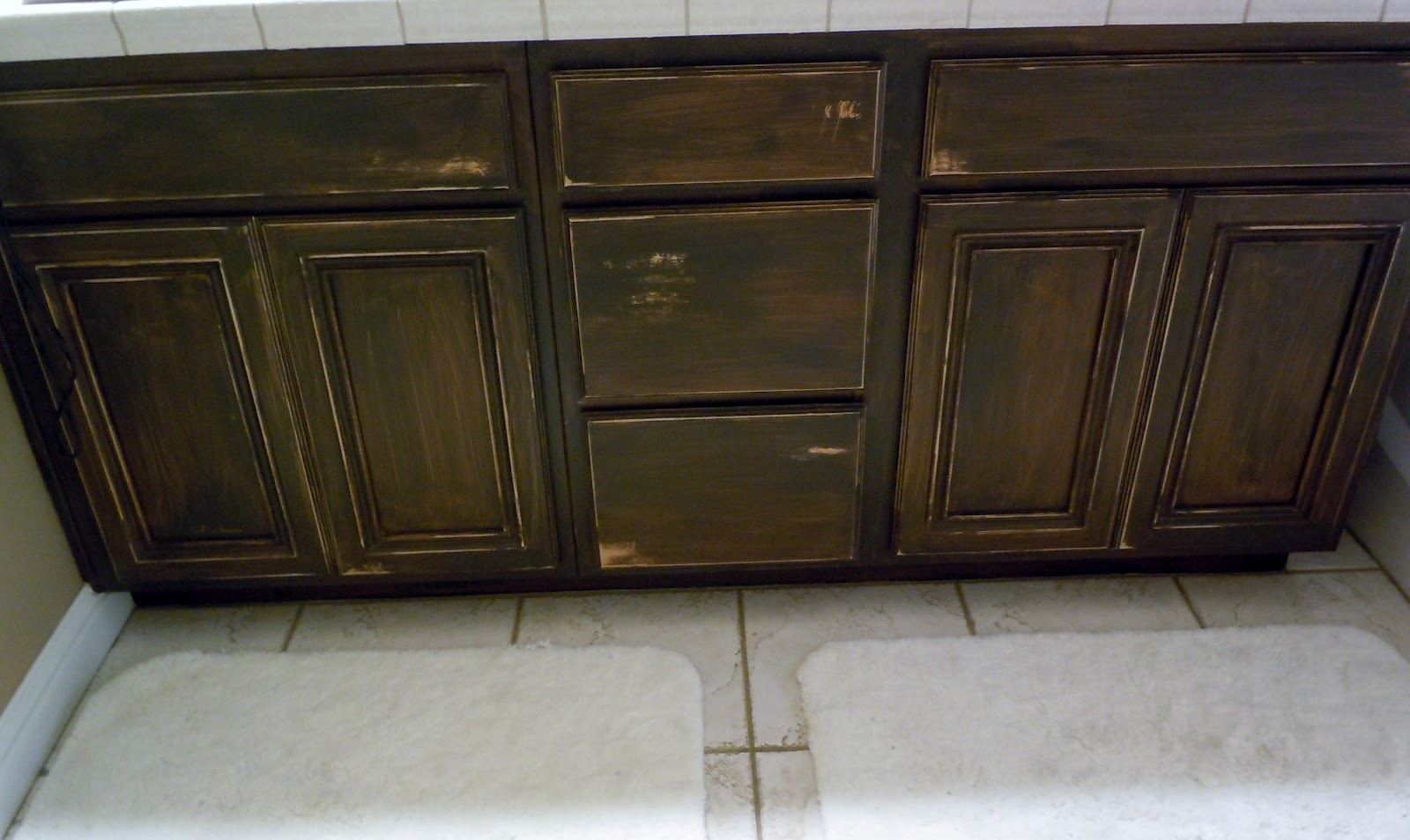 em's crafty chronicles: bathroom cabinet refinish