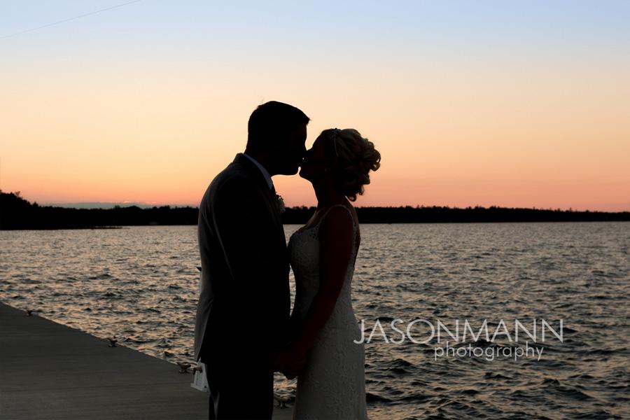 Sunset kiss at a Door County wedding. Photo by Jason Mann Photography, 920-246-8106, www.jmannphoto.com