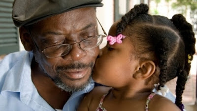 Black grandparent with granddaughter