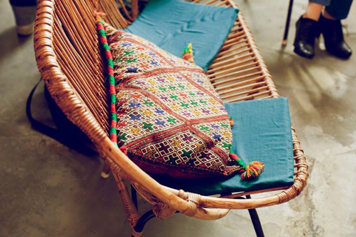 wicker sofa and colorful cushions