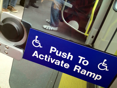 photo of push to activate ramp on LRT