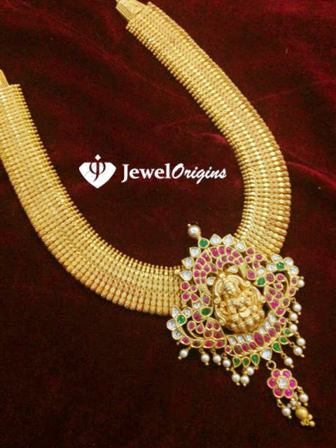 Jewelorigins indian designer gold and diamond jewelleryindian 22 carat gold antique finish haram with lakshmi pendant studded with rubies emeralds and polkis aloadofball Gallery