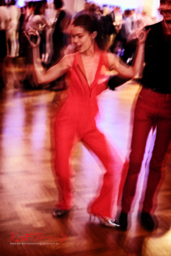 Model and actress Nicola Willow in a red jumpsuit dancing at The Social Party at Pelicano David Jones for VFNO