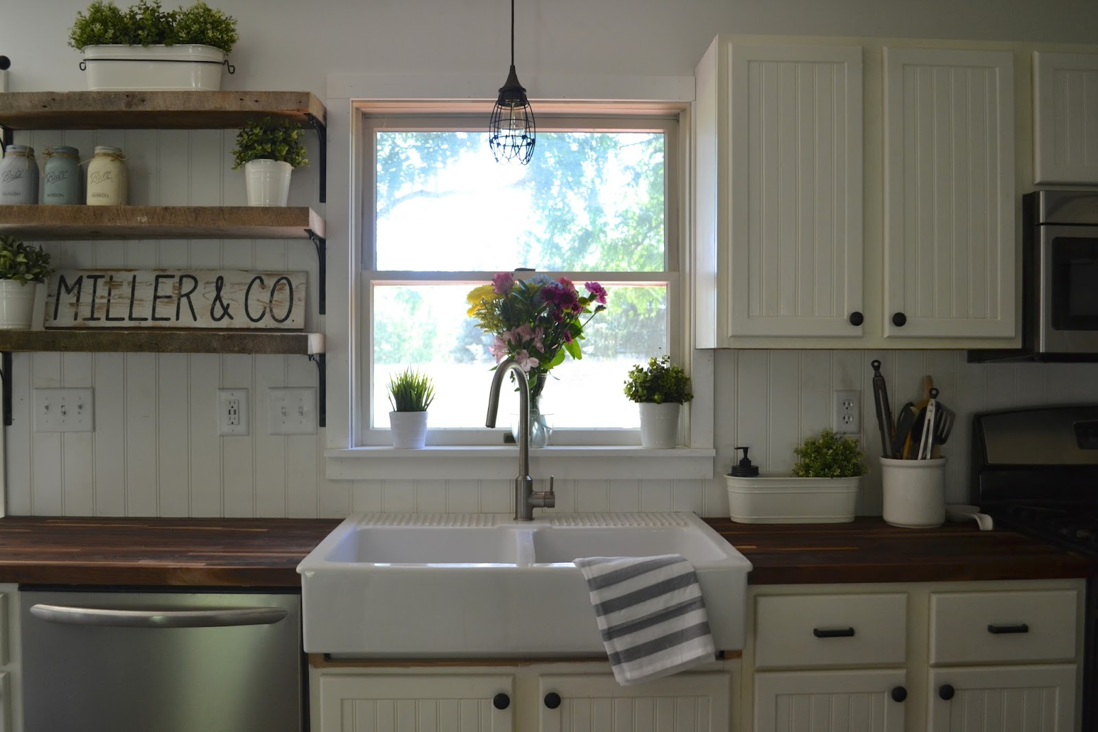 Those barn doors lead into our laundry room and half bath. They make ...