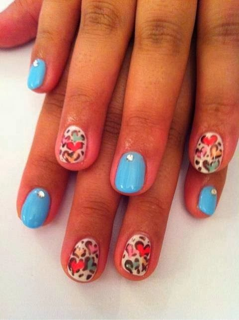 Gel-color Manicure with a soft neon blue clear crystals as feats on the Blue nails
