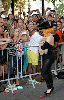 Lady Gaga fosing with her pup named Fuzzi for fans