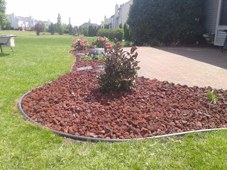 Brick paver patio design installation and maintenance for Landscaping rocks ann arbor