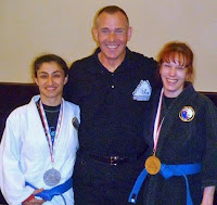 A black belt and two blues
