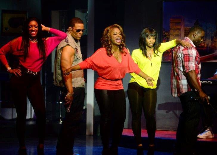 Kandi Burruss (center) and the cast of A Mother's Love