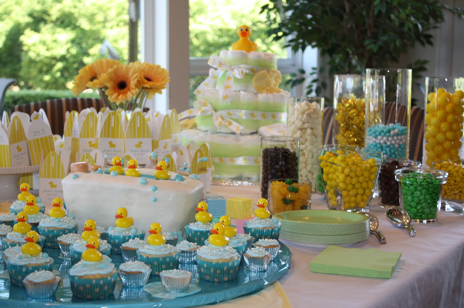 the sweets table included candy cupcakes and a cake shaped as a