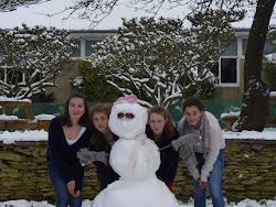 Posing with someone else's snowman!