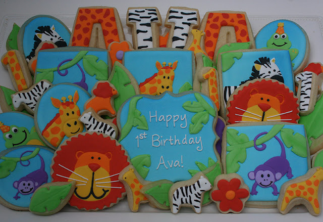 Jungle-themed 1st birthday cookie platter