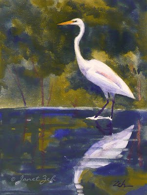 a great egret is reflected in the waters of a shallow pond