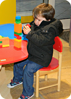 Small boy playing LEGO Duplo LEGOland Discovery Centre Manchester entrance