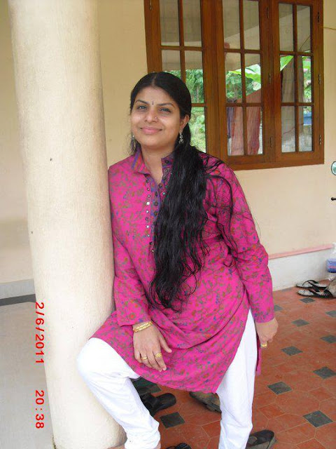 Beautiful malayalam aunt with wet long hair.
