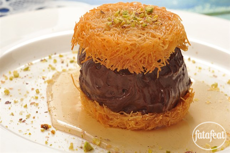 Let mixture boils then reduce the heat to low for Knafeh with chocolate recipe