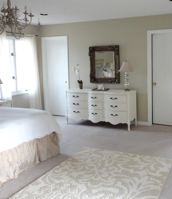 This is a really great budget bedroom makeover. Love the before and after pics!