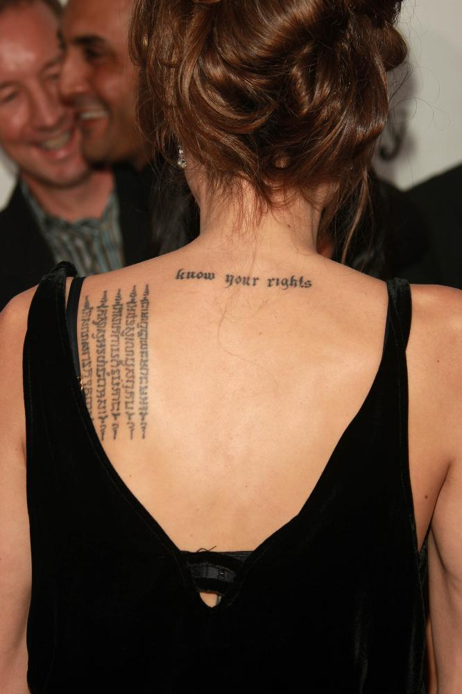 angelina jolie breast tattoos