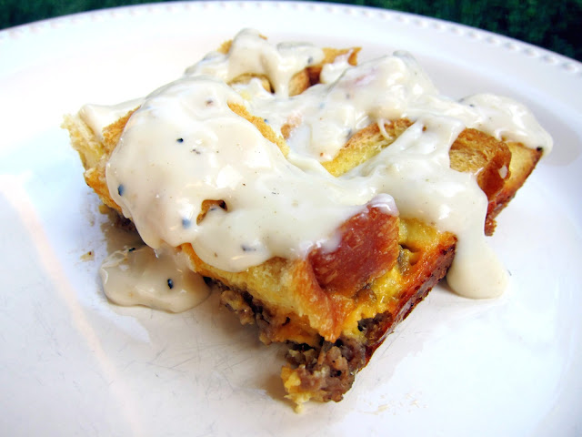Sausage Gravy Breakfast Bake - sausage, cheese, eggs, bread and gravy - quick breakfast bake with crispy bread on top and drizzled with sausage gravy - SOOO good! We like to eat this for breakfast and dinner.