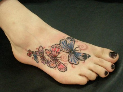 Available butterfly foot tattoo designs for Sparkling star tattoo