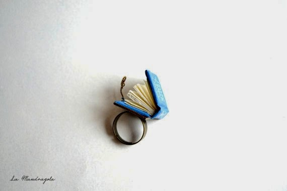 https://www.etsy.com/listing/122224875/tiny-book-ring-tardis-doctor-who?ref=favs_view_4