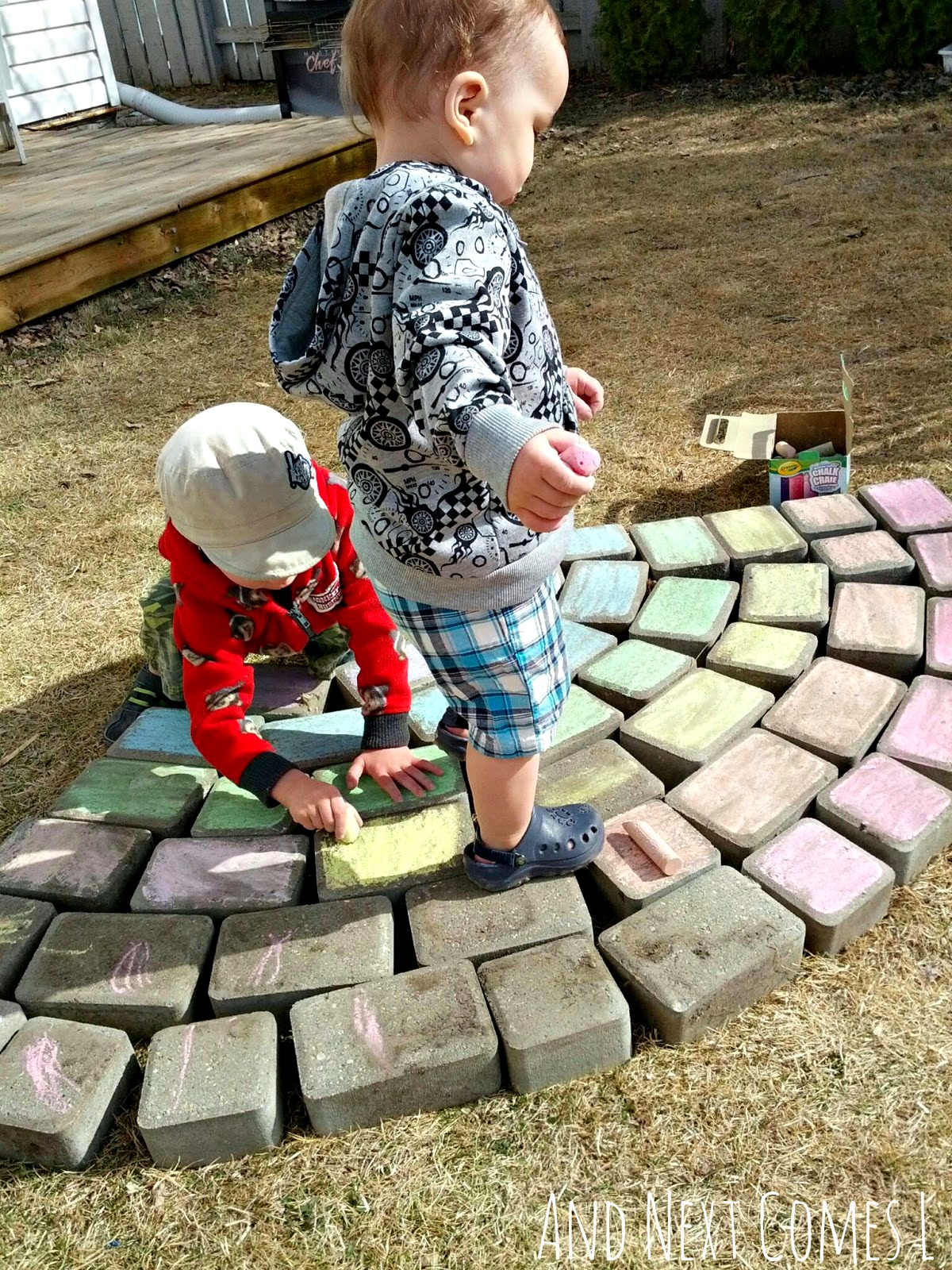 Sibling play: coloring a giant chalk rainbow together from And Next Comes L