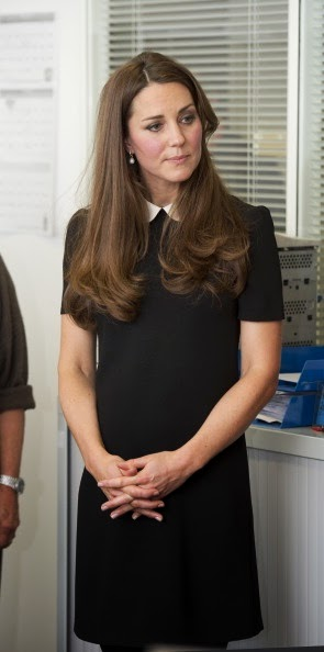 Catherine Middleton wears white Goat coat and Topshop dress, March 2013