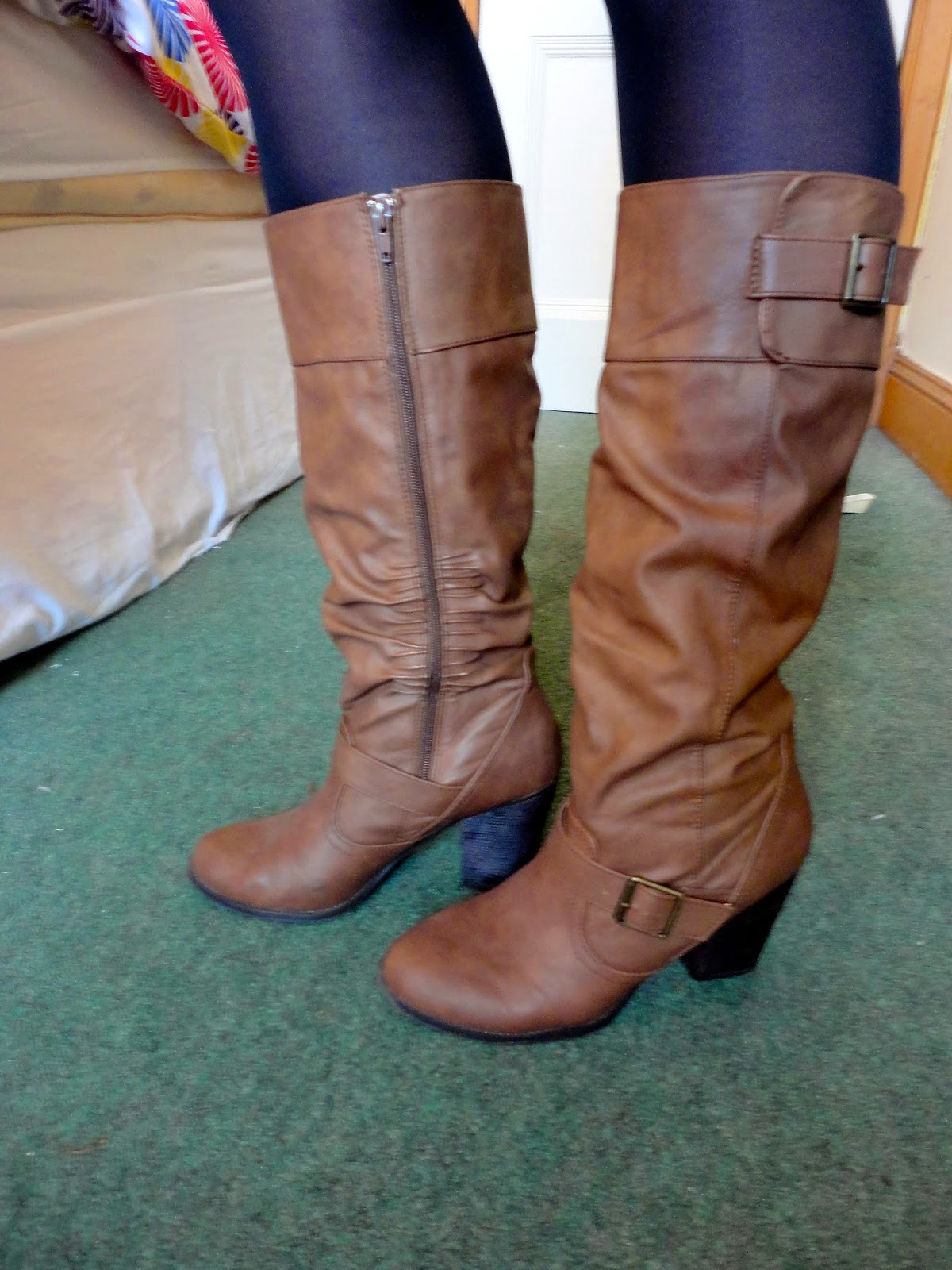 Brown leather knee-high heeled boots