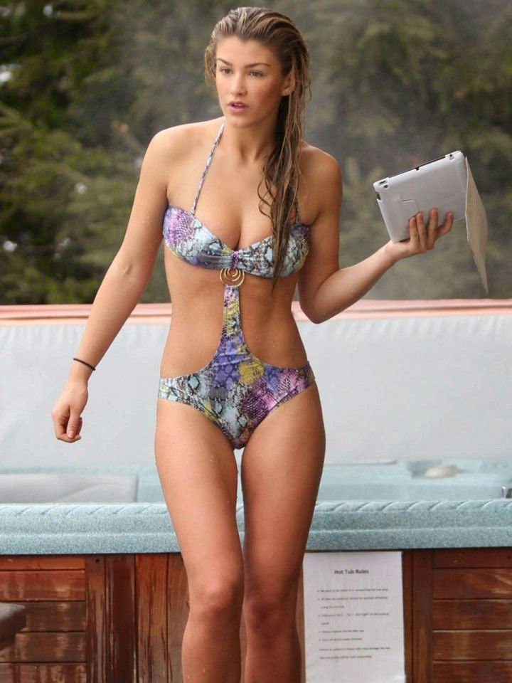 The 21-year-old, Amy Willerton's glam floral bikini at matches during her revealed vacation in Switzerland on Thursday, May 22, 2014.