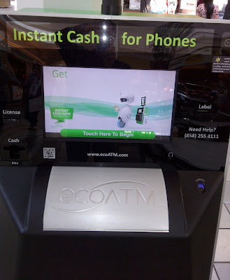 a machine that evaluates your cell phone and dispenses cash