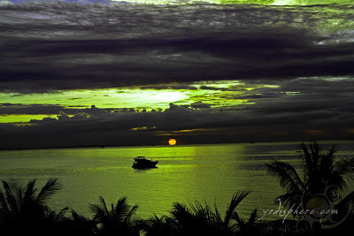 Cruise ship sailing towards the Manila bay amazing orange sunset at Manila Bay Philippines