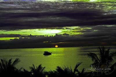 Cruise ship sailing towards the Manila bay amazing orange sunset at Manila Bay Philippines
