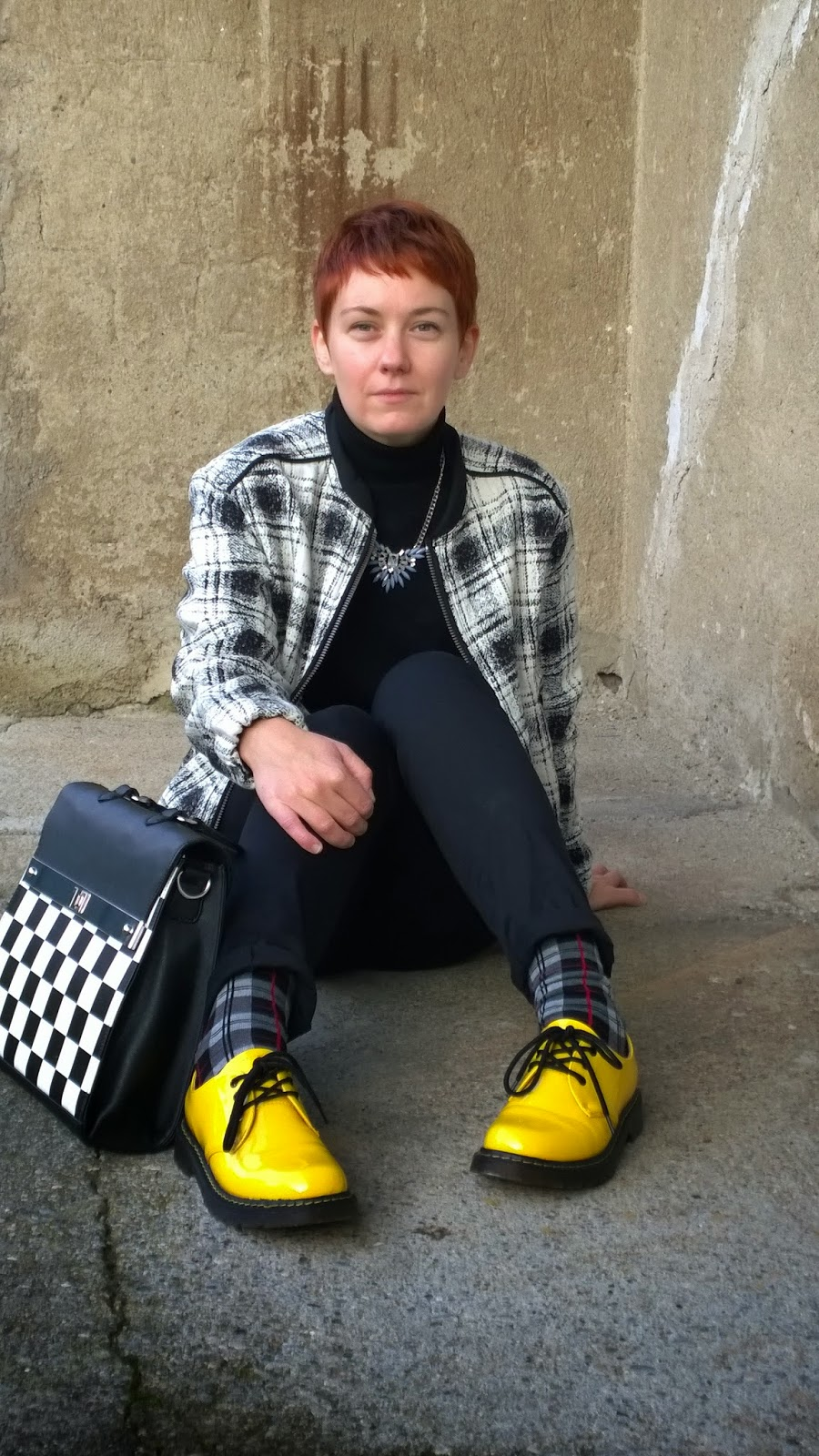 yellow lace up shoes, chessboard check messenger bag, plaid socks, plaid bomber jacket, short red hair