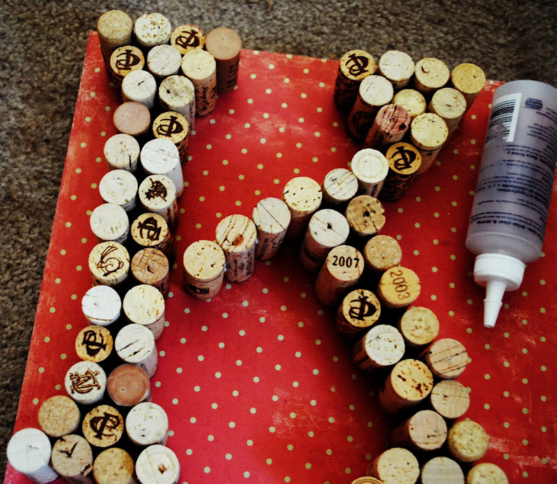 letter k made from recycled wine corks on red and white background