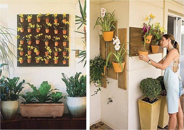 jardim vertical latas:Existem vasos e placas de fibras de coco que dão um lindo visual